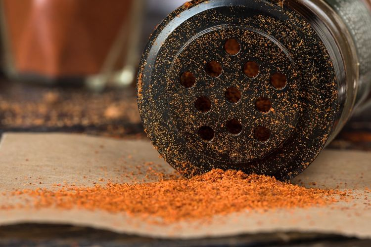 Close-Up Of Cayenne Pepper By Condiment Shaker