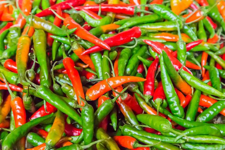 Chillies Abundance Backgrounds Close-up Day Food Food And Drink Freshness Full Frame Green Chili Pepper Green Color Ingredient Nature No People Outdoors Pepper Red Spice Vegetable