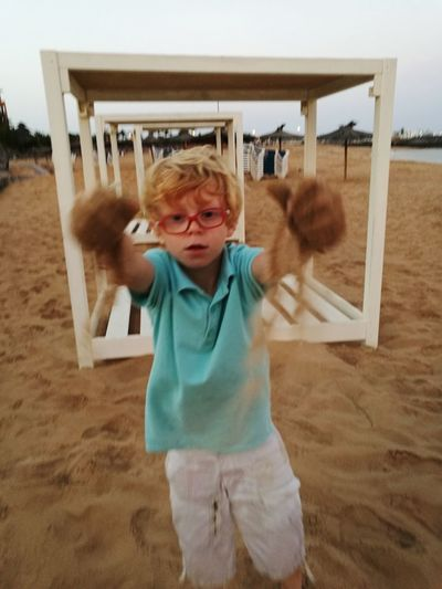 Blond Hair Child Childhood Standing Sky Shore Dust Sandy Beach Sand Head And Shoulders