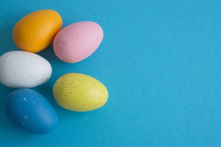Multi Colored Egg Blue Food Food And Drink Celebration Studio Shot Indoors  Colored Background No People Still Life Copy Space Group Of Objects Blue Background Easter Easter Egg Holiday Medium Group Of Objects Close-up Yellow Pink Color White Orange Color Pink