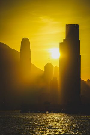 Reframinghk Discoverhongkong Shadow And Light Sunset Sky Architecture Sunset Water Sunlight Built Structure Sun Orange Color Silhouette No People Nature Waterfront Lens Flare Beauty In Nature Reflection Building Exterior Building City Sea Outdoors