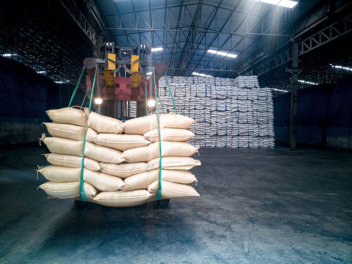 Sacks on machinery in factory warehouse