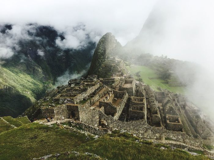Old ruins on mountain in foggy weather