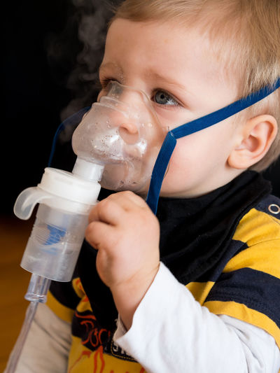 Caucasian boy taking inhalation with oxygen mask in hospital Child Childhood Holding Indoors  Headshot Inhaling Boy Asthma Medical Oxygen Mask Health Medicine Treatment Allergy Patient Small Care Breath Respiratory Caucasian Kid Little Healthcare And Medicine Face Air Flu Innocence Close-up