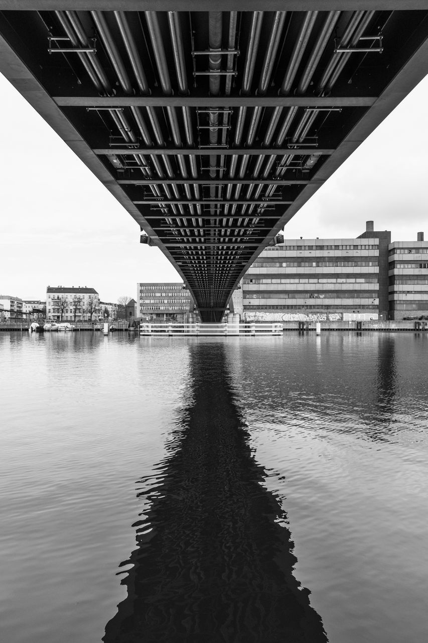 bridge - man made structure, connection, architecture, built structure, engineering, river, transportation, water, below, underneath, waterfront, outdoors, day, bridge, no people, building exterior, sky, city, covered bridge, chain bridge
