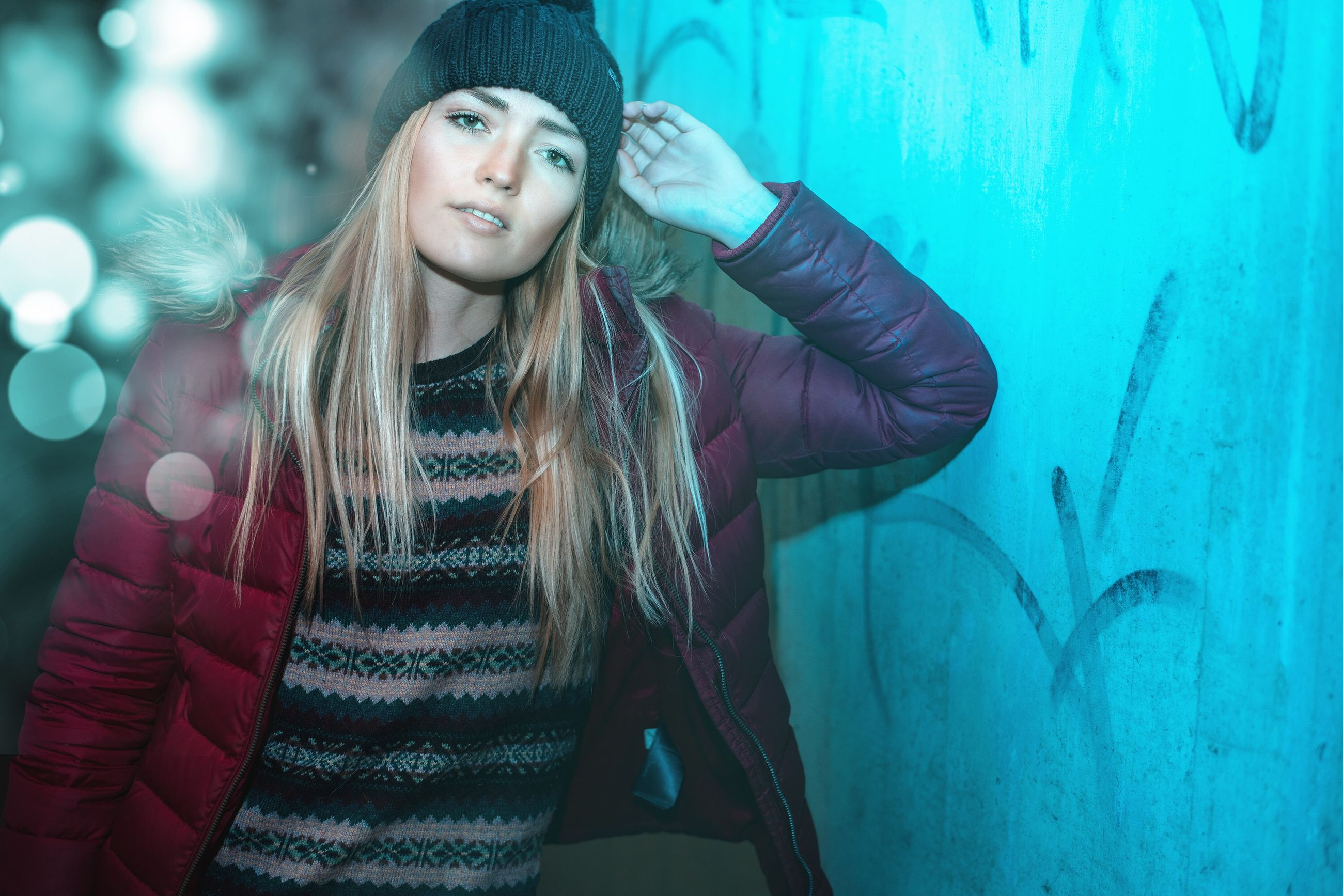 one person, young adult, front view, long hair, clothing, leisure activity, young women, real people, hair, looking at camera, portrait, lifestyles, hairstyle, hat, standing, women, smiling, wall - building feature, beautiful woman, warm clothing, teenager