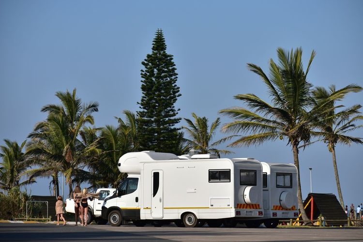 Camping By The Beach Seaside Camping Parked Motorhome Park Picnicking Area Swimwear People Tree Palm Tree Land Vehicle Car Stationary Motor Home Sky Parking Parking Lot #urbanana: The Urban Playground