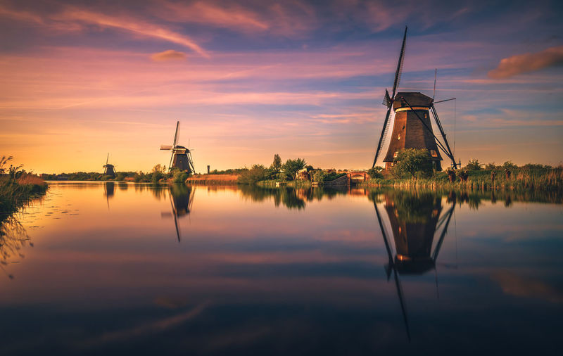 Kinderdijk Amsterdam Dutch Holland Remo SCarfo Reflection Sky Sunset Water Cloud - Sky Waterfront Nature Orange Color Beauty In Nature No People Wind Turbine Tranquility Turbine Lake Scenics - Nature Renewable Energy Fuel And Power Generation Alternative Energy Wind Power Sailboat