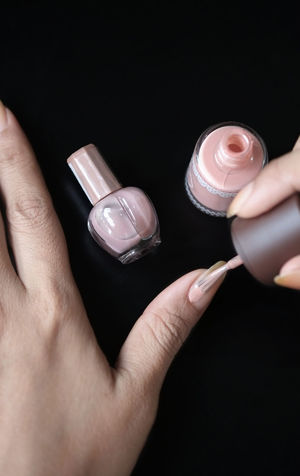 Adult Adults Only Beauty Black Background Bottle Business Finance And Industry Close-up Fingernail Fingernails Polish From Above  Human Body Part Human Hand Indoors  Nail Painting Nail Polish People Pinting Top View Water Wedding Woman