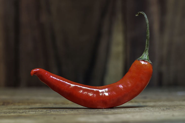 Close-up Of Red Chili Pepper On Table