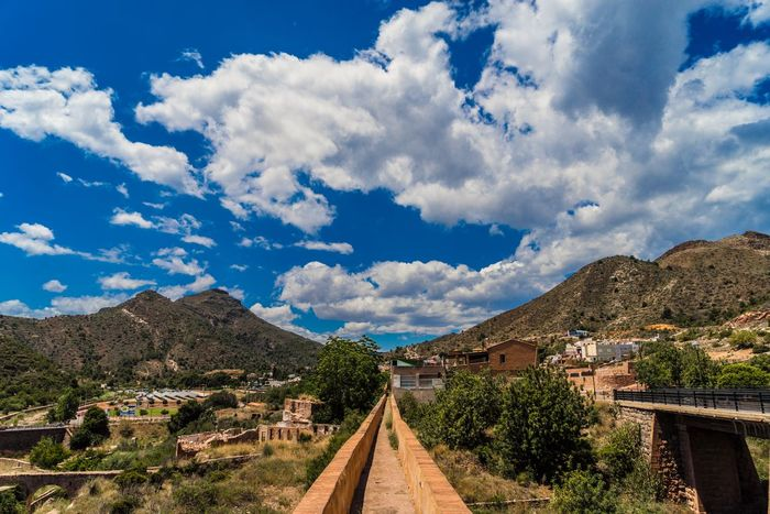 Follow your path Aqueduct Beauty In Nature Blue Cloud Cloud - Sky Cloudy Day Diminishing Perspective Green Color Landscape Mountain Mountain Range Narrow Nature No People Non-urban Scene Outdoors Plant Scenics Sky The Way Forward Tranquil Scene Tranquility Tree Vanishing Point