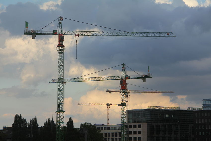 Architecture Building Exterior Built Structure City Cloud Cloud - Sky Cloudy Construction Construction Industry Construction Machinery Construction Site Crane Crane - Construction Machinery Development Downtown District Growth Improvement Incomplete Low Angle View Outdoors Progress Sky Tall Tall - High Urban Skyline