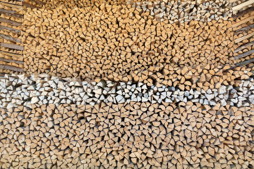 Hugh wood pile with many small pieces of wood, neatly stacked with an interesting pile pattern BIG Stack Wood Wood Billet Woodpile Background Brown Firewood Heap Hugh Large Log Many Neatly Pattern Pile Piled Stacked Stock Stockpile Storage Supply Texture Wood Pile Wood Storage