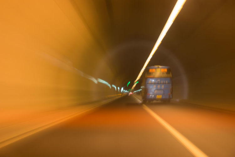 Blurred motion of bus in tunnel