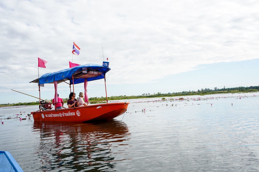 Water Nautical Vessel Transportation Mode Of Transportation Sky Flag Waterfront Sea Nature Travel Patriotism Men Day Real People Leisure Activity Group Of People Incidental People People Lifestyles Outdoors Kumphawapi Red Lotus In Thailand Red Lotus Thailand Red Lotus Lake ทะเลบัวแดง