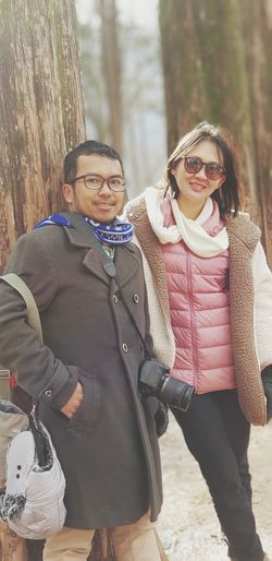 Vacation Holiday Moments Warm Clothing Friendship Young Women Tree City Bonding Togetherness Cold Temperature Portrait Smiling Arm In Arm Teenage Couple Boyfriend Twin Girlfriend Romance Young Couple Romantic Activity Winter Coat Love At First Sight