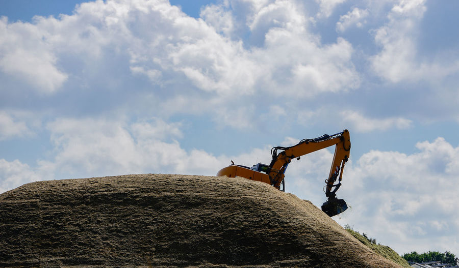 Low angle view of man on rock against sky