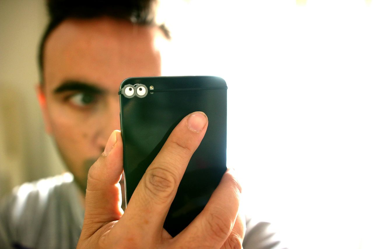Close-Up Of Man Holding Smart Phone
