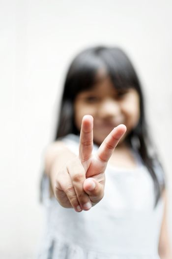 Girl gesturing peace sign