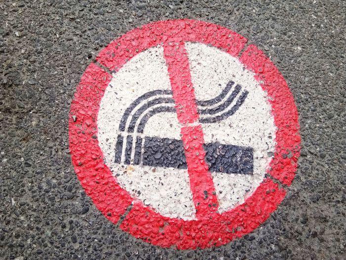 Close-up of no smoking sign on wall