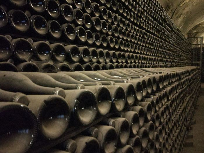 Large Group Of Objects Wine Wine Cellar Wine Bottle Bottle Cellar In A Row Drink Refreshment Indoors  Abundance Alcohol Stack Container Winery Arrangement Winemaking Architecture Rack Food And Drink No People Order Dust
