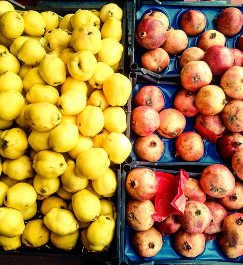 Quinces & Pomegranates. Two very different fruit, happily coexisting together, why can't people be more like this? Quince Quinces Pomegranate Pomegranates  Fruit Fruit Shop Two Things Side By Side Colourful Manchester