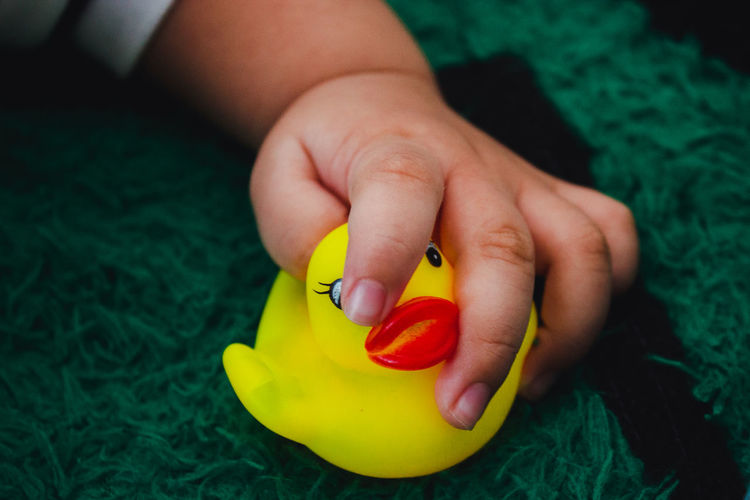 Duck Toy Playing People Yellow First Eyeem Photo Still Life Baby Hand Hand My Best Photo Human Hand Beauty Close-up Green Color Finger Body Part Tiny Fingernail #NotYourCliche Love Letter