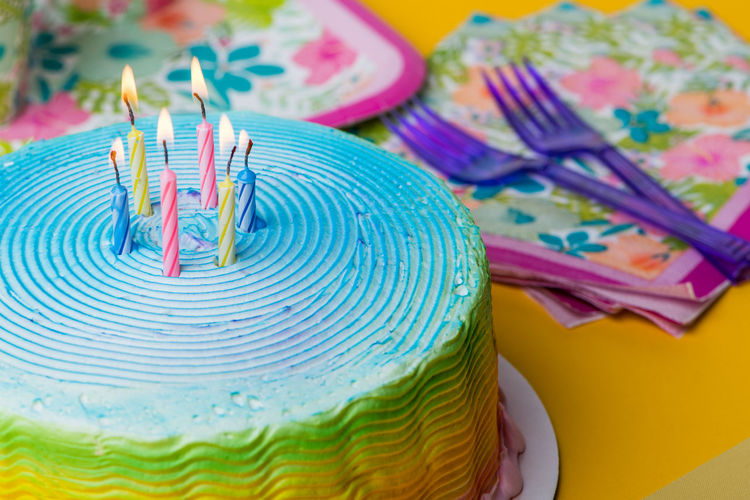 Colorful frosted cake with party supplies Candles Celebration Cinco De Mayo Frosting Icing Lunch Napkins Picnic Birthday Cake Cake♥ Colorful Colorfull Decorated Forks Party Rainbow Summer Tropical