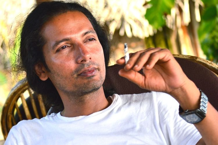 Relaxed drag of tobacco Long Hair Man Cigarette Smoking Cigarette Smoker Cigarette Time Smoking - Activity Smoking Bad Habbit Unhealthy Lifestyle Unhealthy Habbit Smoking Causes Cancer EyeEm Selects Human Hand Portrait Men Headshot Human Face Beautiful People Young Men Males  Handsome Close-up