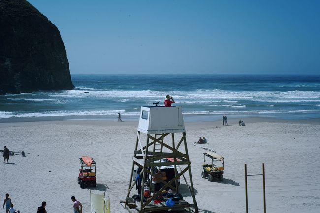 Cannon Beach Travel Beach Beach Patrol Beauty In Nature Crowd Group Of People Horizon Horizon Over Water Leisure Activity Lifeguard  Lifeguard Station Lifeguard Tower Lifestyles Men Nature Oregon Coast Outdoors Real People Scenics - Nature Sea Sky Vacations Water Women