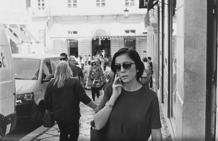 The Street Photographer - 2017 EyeEm Awards Streetphotography Portugal Lisboa Real People Sunglasses Building Exterior Young Women Standing Day Outdoors Lifestyles Built Structure Young Adult Architecture Women City Adult Adults Only People