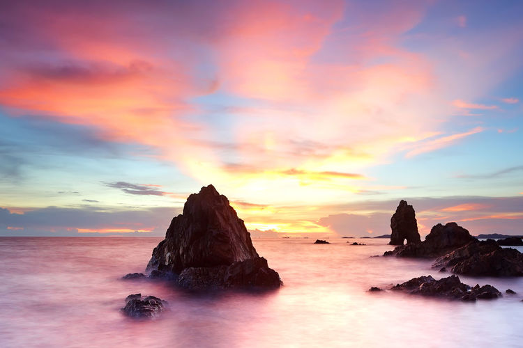 Beautiful sunset on tropical beach at Chonburi province, Thailand Sea Sky Rock Sunset Beauty In Nature Water Solid Rock - Object Cloud - Sky Tranquil Scene Scenics - Nature Tranquility Horizon Over Water Rock Formation Horizon Idyllic Nature No People Orange Color Outdoors Stack Rock Purple Romantic Sky Eroded Beautiful