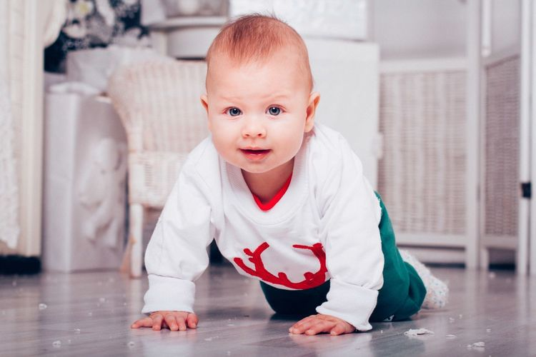 Portrait of cute baby crawling