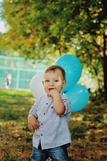 Child Childhood One Person Innocence Plant Cute Three Quarter Length Casual Clothing Outdoors Day Babyhood Young Standing Tree Focus On Foreground Nature Real People Baby Portrait The Modern Professional Moms & Dads