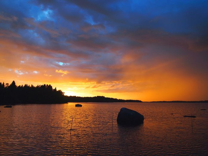 A sudden change in the gray weather gone in 15 min. Sunset Silhouettes Sunset And Clouds  Sunset_collection Beauty In Nature Clouds Lake View Nature Nature_collection Nature_perfection Naturelovers No People Orange Color Outdoors Reflection Scenics Silhouette Sky Sunset Tranquility Water