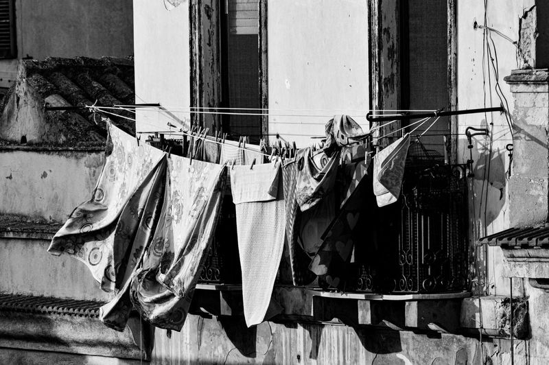 Clothes drying on rope against building