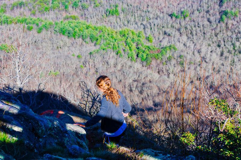 Woman sitting on a field
