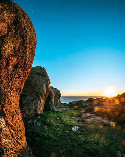 Sky Rock Scenics - Nature Tranquil Scene Tranquility Beauty In Nature Rock - Object Rock Formation Solid Nature No People Sunset Water Sea Clear Sky Non-urban Scene Land Blue Idyllic Outdoors Eroded Formation Stones Beachphotography Sardegna Sardinia Sardinia Sardegna Italy  Travel Destinations Travel Travel Photography Travelling Italy❤️ Italia FishEyeEm Fisheye Sonyalpha