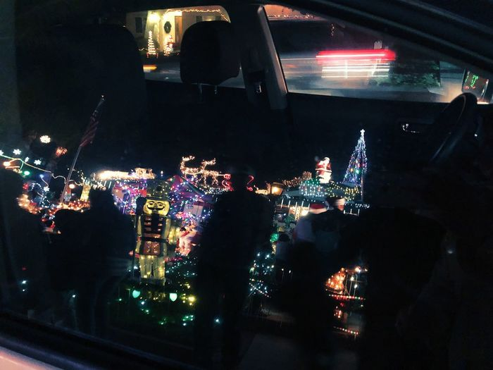 Christmas lights - reflections Illuminated Night Lighting Equipment Real People Crowd Architecture Nightlife Mode Of Transportation Large Group Of People Light - Natural Phenomenon Motor Vehicle Transportation Decoration Group Of People Car Arts Culture And Entertainment Window Lifestyles Indoors  City