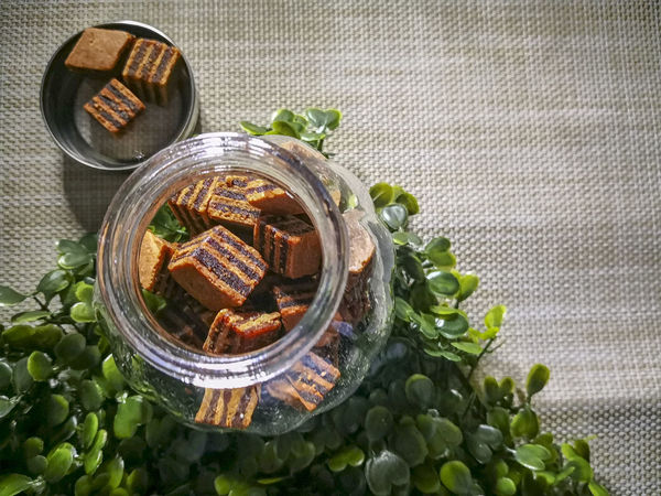 Closeup and selective focus a Sarawak Layer Cake or local called Kek Lapis with minimal lighting and flare serve on the top of table. Sarawakmalaysia Layer Cakes Food And Drink Food Healthy Eating Vegetable Freshness Indoors  Wellbeing Directly Above No People Table Bowl Still Life Container Ready-to-eat High Angle View Tablecloth Fruit Close-up Nature Asian Food