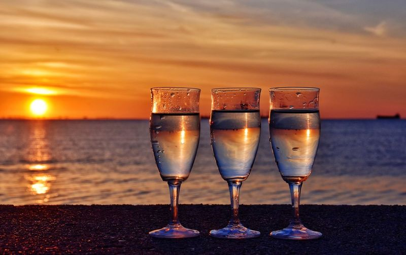 wineglass on sunrise background in gdynia, poland EyeEm Selects Liqueur Water Sea Alcohol Sunset Drink Beach Wineglass Drinking Glass Cocktail Seascape Beach Party Spring Break Pool Party Coast Horizon Over Water Shot Glass Romantic Sky Champagne