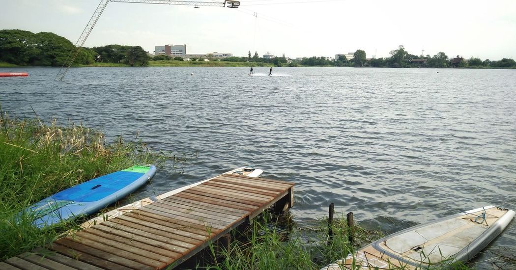 Water Lake Day No People Outdoors Wave Stand Up Paddle SUP Surf Wakeboard Lake Having Fun Wakeboarding Wakeboard Sup Lakeside Tranquility Nautical Vessel Nature Tree Sky Grass
