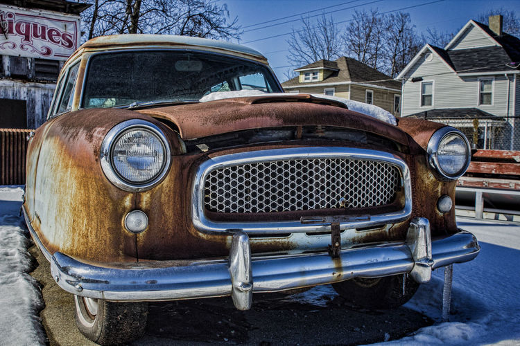 Rusting away. Automobile Car Derelick Headlight Junk Land Vehicle Mode Of Transport Outdoors Parked Rust Stationary Transportation Vintage Car
