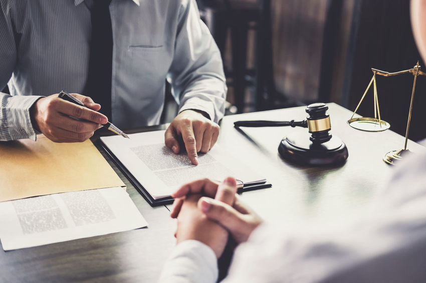 Lawyer Barrister Business Businessman Communication Consultant Counselor Document Fairness Hand Holding Human Hand Indoors  Judge Judgement Legal Legislation Men Notary Office Paper People Selective Focus Verdict Writing