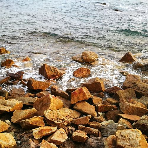 Beach Nature Shore Water No People Sea Day Outdoors Sand Pebble Beauty In Nature Full Frame Wave Pebble Beach Close-up