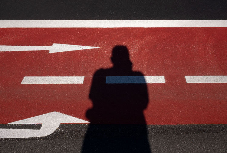 Directions One Person High Angle View Shadow Red Day Sunlight Focus On Shadow Direction Directional Sign Mind  Mindfulness Ralfpollack_fotografie Fujix_berlin A New Beginning A New Perspective On Life