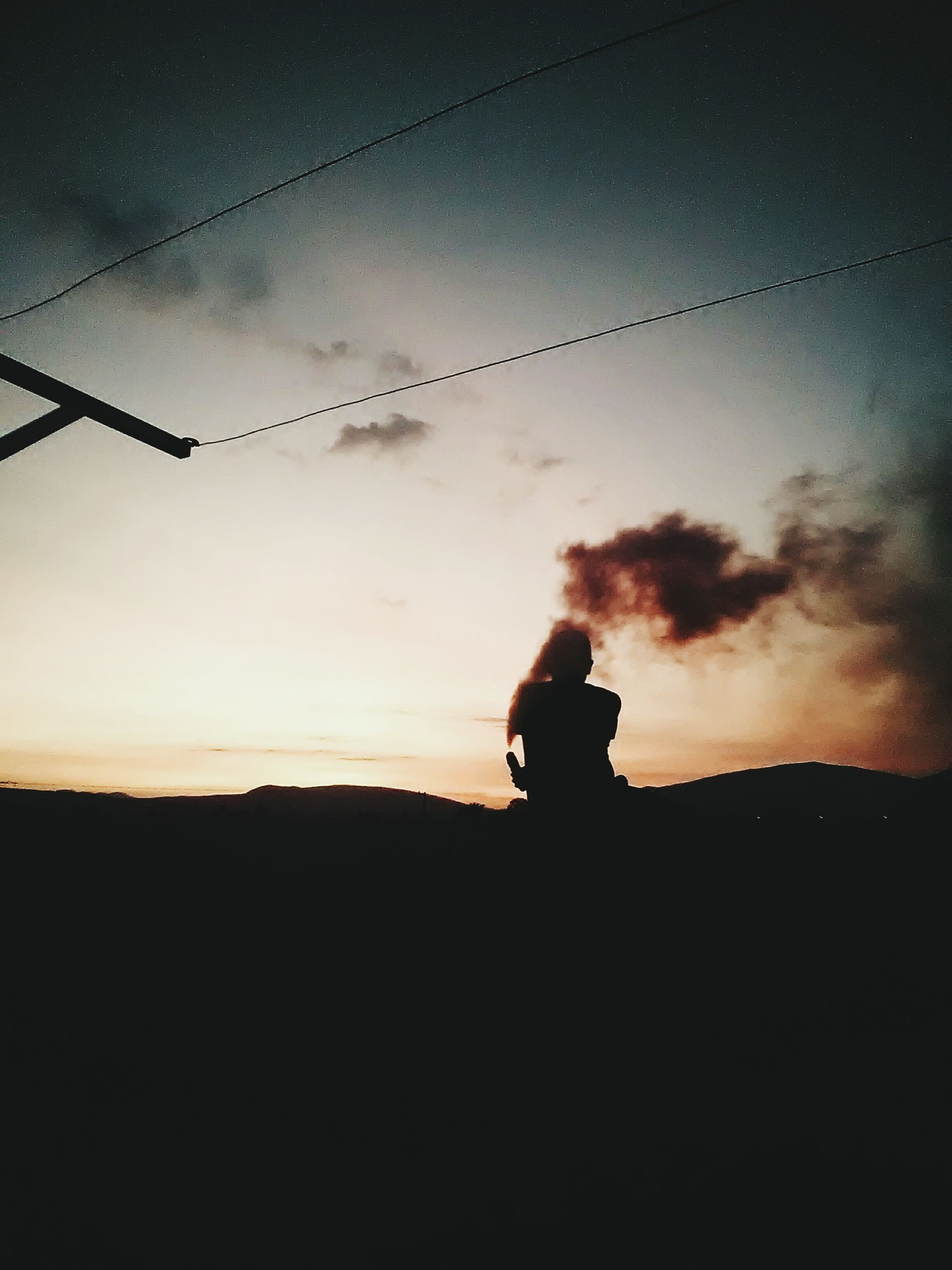 silhouette, sunset, sky, real people, nature, one person, leisure activity, beauty in nature, men, standing, outdoors, landscape, scenics, sitting, day, people