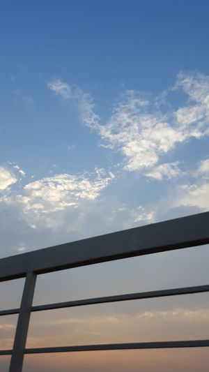 Sky Sunset No People EyeEm Blue Yellow EyeEmPaid EyeEm Gallery Eye4photography  Eyeem Market Photography Clouds And Sky Cloud Formations Cloudscapes Grill Abundance Selling Photos Railing Rooftopphotography Roof Rooftop