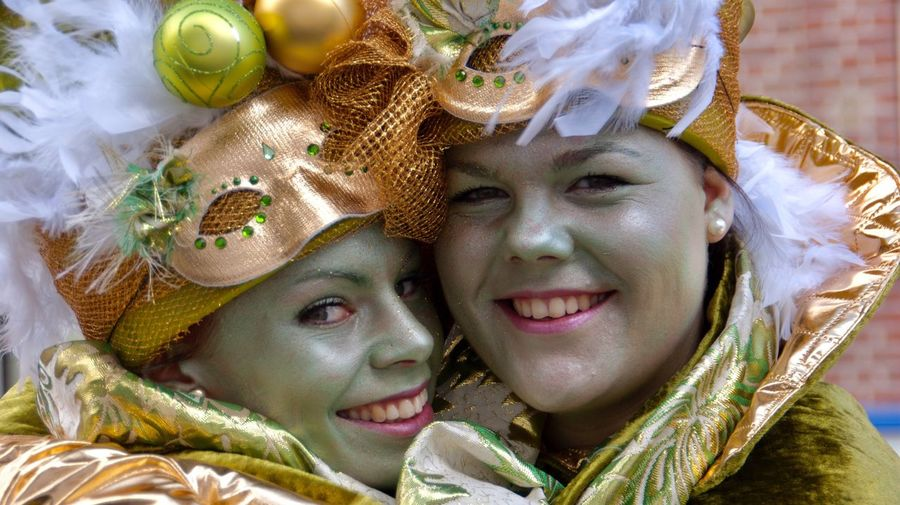 Carnival Two People Real People Smiling Girls Happiness Gold Colored Tradition Painted Faces Headshot Child Lifestyles Portrait Celebration Cheerful Childhood Beauty Close-up Young Women Togetherness Outdoors Event Day Carnival Crowds And Details
