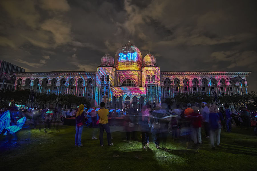 PUTRAJAYA - DECEMBER 31: A colorful projection mapping show with the background view of Palace Of Justice on December 31, 2017 in Putrajaya. Landscape_Collection Architectural Column Architecture Building Exterior Built Structure Cloud - Sky Crowd Day Illuminated Landscape Landscape_photography Large Group Of People Leisure Activity Lifestyles Men Nature Outdoors People Projection Mapping Projection Screen Real People Sky Travel Destinations Women